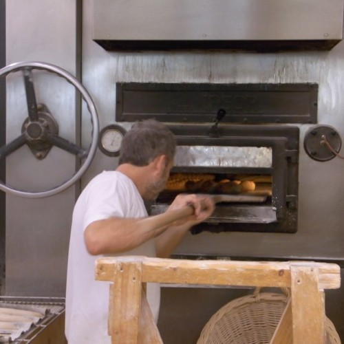Loading the wood fired oven at Baluard bakery, Barceloneta, Barcelona